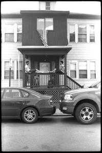 Upon porch hangs...